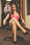 Ms. Gem client services. She's about to deliver a sound spanking to the poor man behind her.